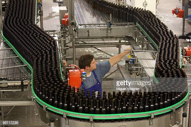 Empty bottles make their way down a conveyor belt at the Weihenstephan brewery on November 16 2009 in Freising Germany The Bavarian state brewery...