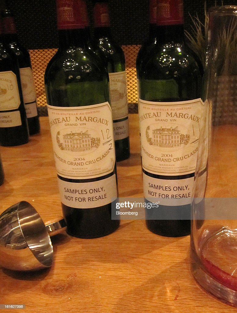Empty bottles of 2004 Chateau Margaux Bordeaux wine sit on a sideboard after a tasting event at Corkbuzz Wine Studio in New York, U.S., on Friday, Feb. 1, 2013. The first-growth Bordeaux chateau has been a hotbed of experiments for more than a decade, even underwriting a dedicated two-person research and development team. Photographer: Elin McCoy/Bloomberg via Getty Images