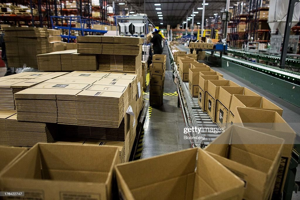 Empty boxes move along a conveyor belt to be filled with orders at the Mary Kay Inc. regional distribution facility in Dallas, Texas, U.S., on Tuesday, Aug. 6, 2013. About 350,000 Mary Kay businesses were started globally in the past year, including 90,000 in the first quarter of 2013, according to a company press release. Photographer: T.J. Kirkpatrick/Bloomberg via Getty Images