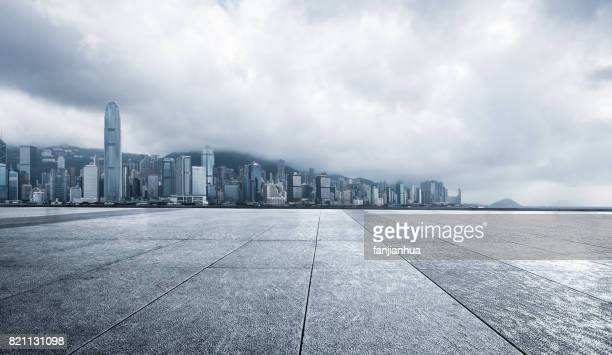 empty brick platform with Hong Kong city in the background