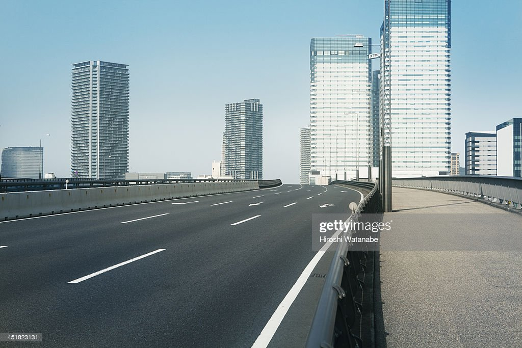 Empty bridge following the skyscrapers