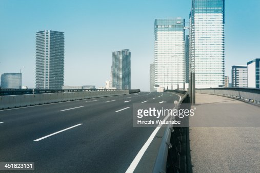Empty bridge following the skyscrapers