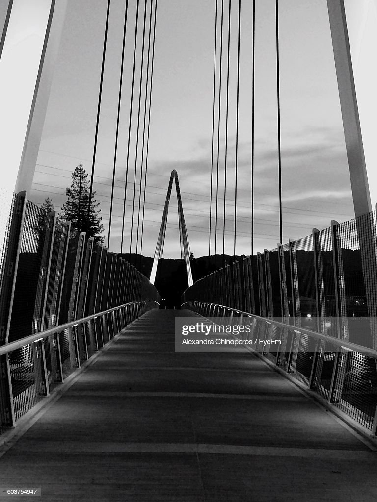 Empty Bridge Over River Against Sky