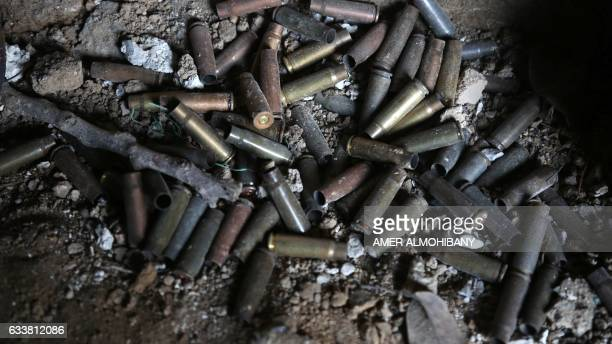 Empty bullet casings are seen on the frontline in the town of Bilaliyah east of the capital Damascus on February 4 where fighters from the Jaish...