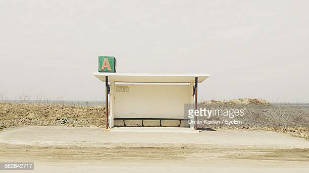 Empty Bus Stop At Roadside