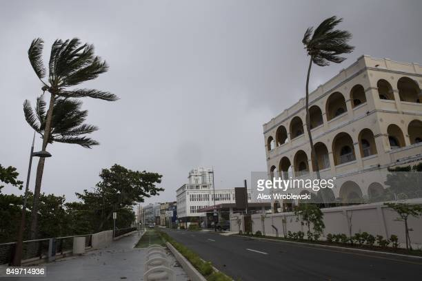 Empty businesses stand along Avenida Munoz Rivera as residents prepare for a direct hit from Hurricane Maria on September 19 2017 in San Juan Puerto...