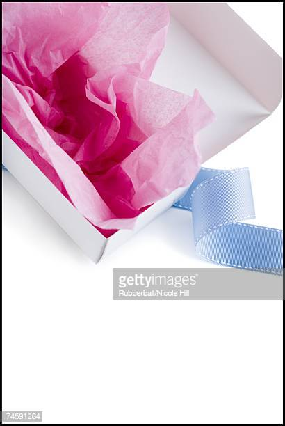 Empty candy box with tissue and ribbon