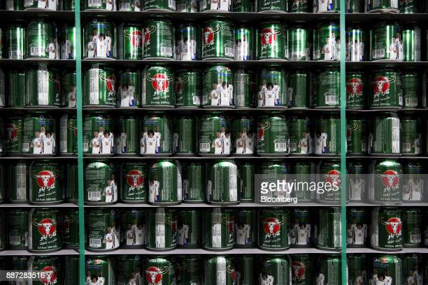 Empty cans for Carabao energy drink sit on shelves inside a storage room at the Carabao Group Pcl plant in Chachoengsao Chachoengsao Province...