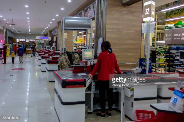 Empty cashier counters in the Lottemart supermarket located in Jiuxianqiao which is the headquarter of Lotte group in Beijing Even on weekends the...