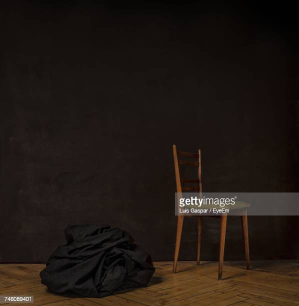 Empty Chair And Bean Bag In Dark Room