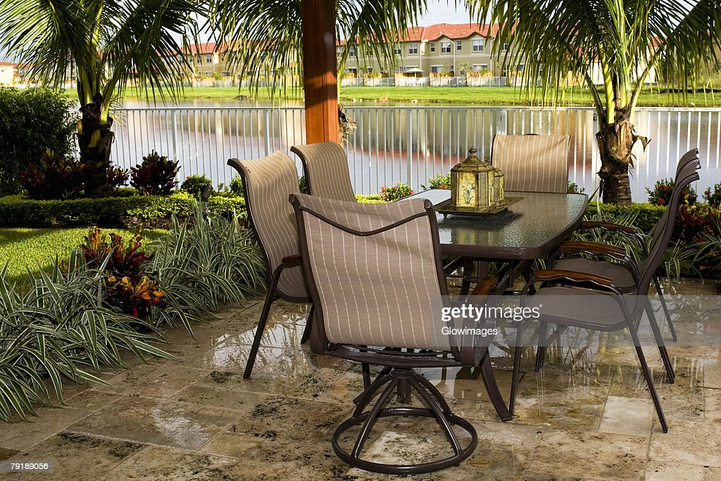 Empty chair and tables in a lawn : Foto de stock