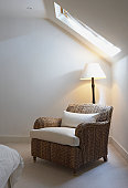 Empty chair near bed