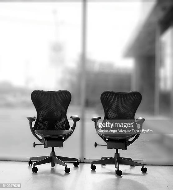 Empty Chair On Floor In Office