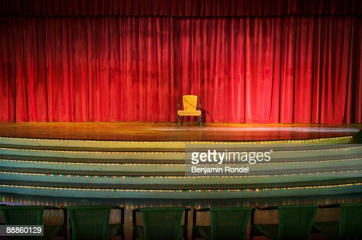 Empty chair on stage