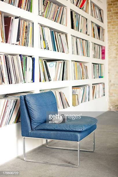 Empty chair with shelf of records