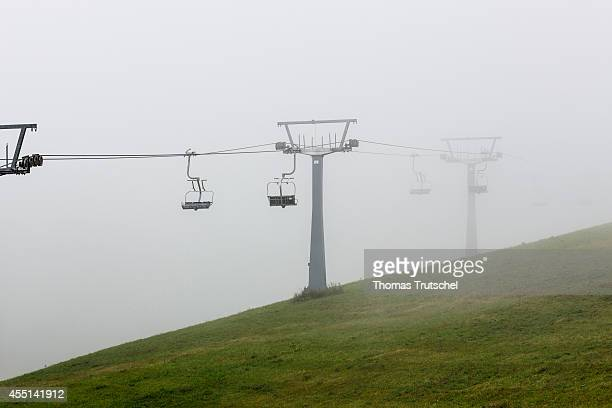 Empty chairlift disappearing in the mist on August 21 in Schmitten Austria