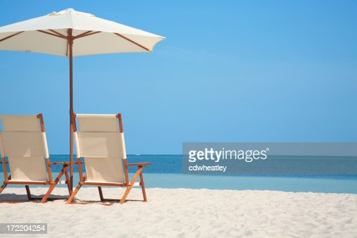 empty chairs and umbrella at a beach in Florida, USA
