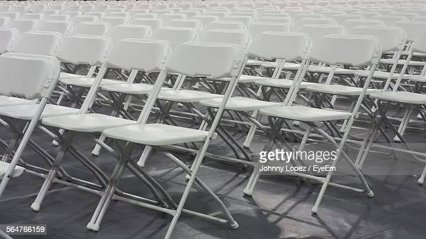 Empty Chairs Arranged In Rows