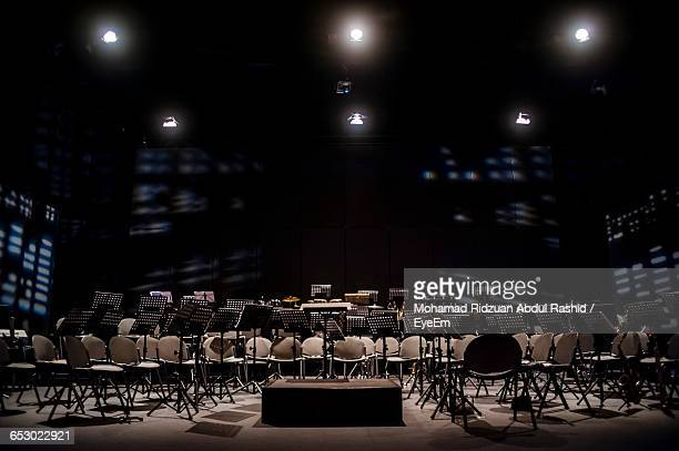 Empty Chairs In Illuminated Recording Studio