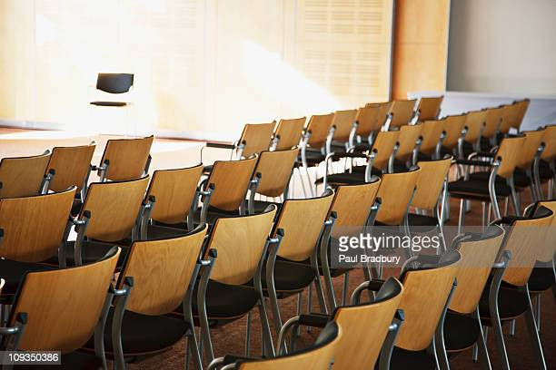 Empty chairs lined up for seminar