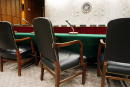 Empty chairs sit in a Senate hearing room set aside for an investigation into the collapse of Enron Corporation February 4 2002 at the Hart Senate...