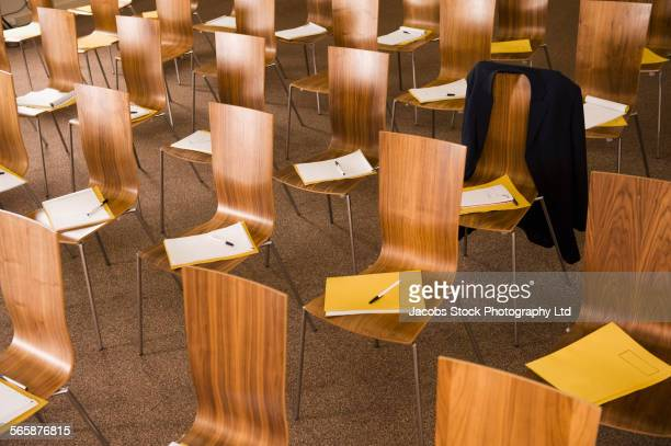 Empty chairs with pamphlets in presentation room