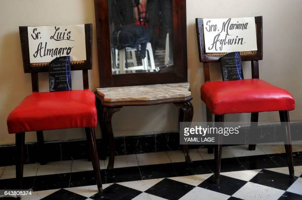 Empty chairs with the names of Organization of American States Luis Almagro and former Chilean education minister Mariana Aylwin are seen at the...
