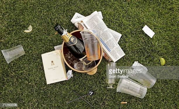 A empty champagne bottle lies in a bucket on the ground after the first day of Royal Ascot at the Ascot Racecourse on June 20 2006 in Ascot England...