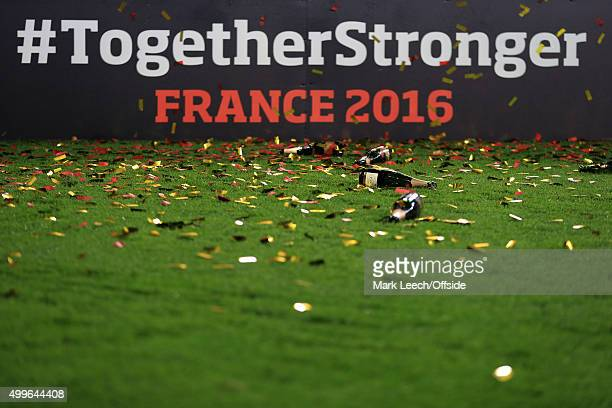 Empty Champagne bottles litter the pitch against the backdrop of a France 2016 advertising board during the UEFA EURO 2016 Group B Qualifier between...