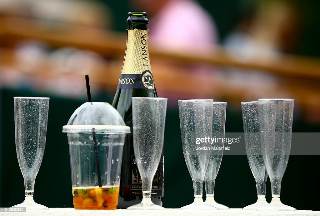 Empty champagne glasses during day four of the Wimbledon Lawn Tennis Championships at the All England Lawn Tennis and Croquet Club on June 30, 2016 in London, England.