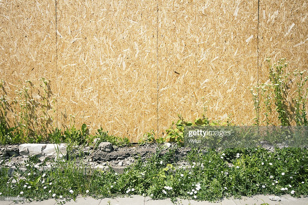 Empty chipboard fence : Stock Photo