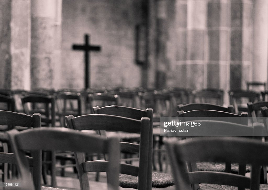 empty church chairs and cross stock photo
