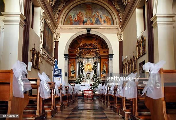 Empty church decorated for wedding