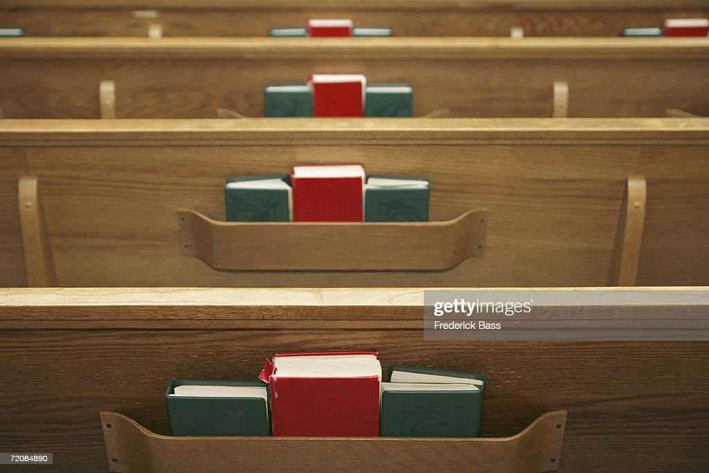 Empty church pews and hymnals