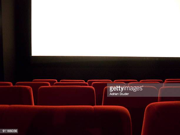 Empty cinema with red chairs