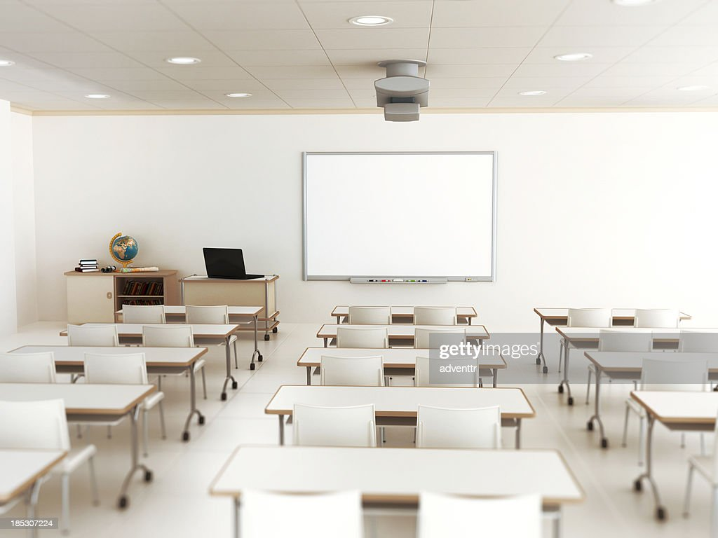 Modern Classroom With Students : Empty classroom with white tables and chairs stock photo