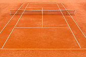High angle view of empty, red clay, tennis court