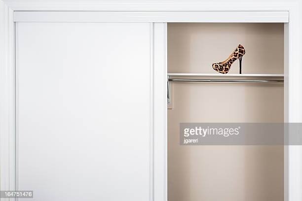empty closet with single leopard high heel shoe