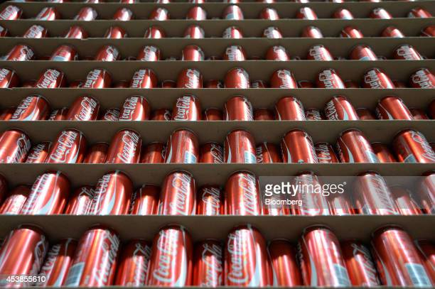 Empty CocaCola Classic cans stand ready for filling at a CocaCola Amatil Ltd production facility in Melbourne Australia on Tuesday Aug 19 2014...