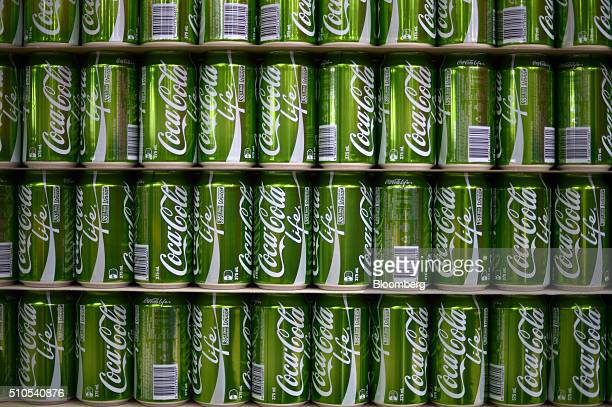 Empty CocaCola Life cans are stacked at a CocaCola Amatil Ltd production facility in Melbourne Australia on Tuesday Feb 16 2016 CocaCola Amatil is...