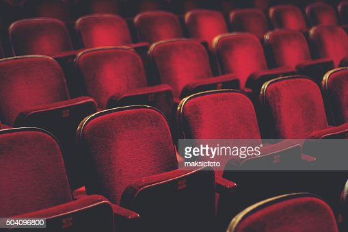 Empty comfortable red seats with numbers in cinema : Stock Photo