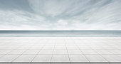 Business concept - Empty concrete floor top with panoramic ocean view of morning dark sky for display or montage product