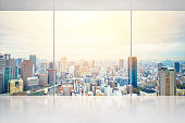 Business and design concept - empty concrete ground and window with panoramic modern urban skyline bird eye aerial day view of Osaka, Japan, for display or mock up