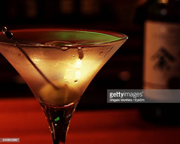 Empty Condensed Martini Glass On Table