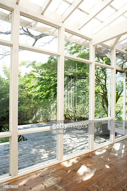 Empty conservatory leading to garden
