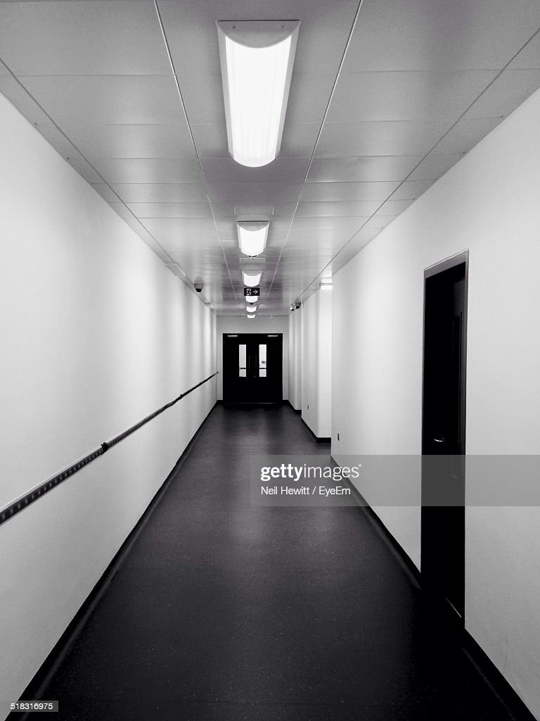 Empty Corridor With Ceiling Lights In Row