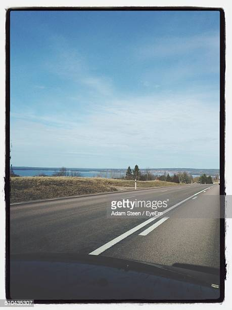 Empty country road along landscape