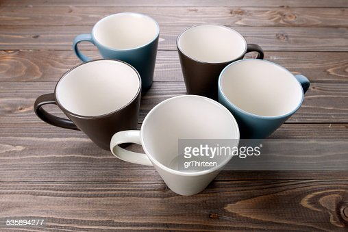 empty cups on wood background : Stock Photo