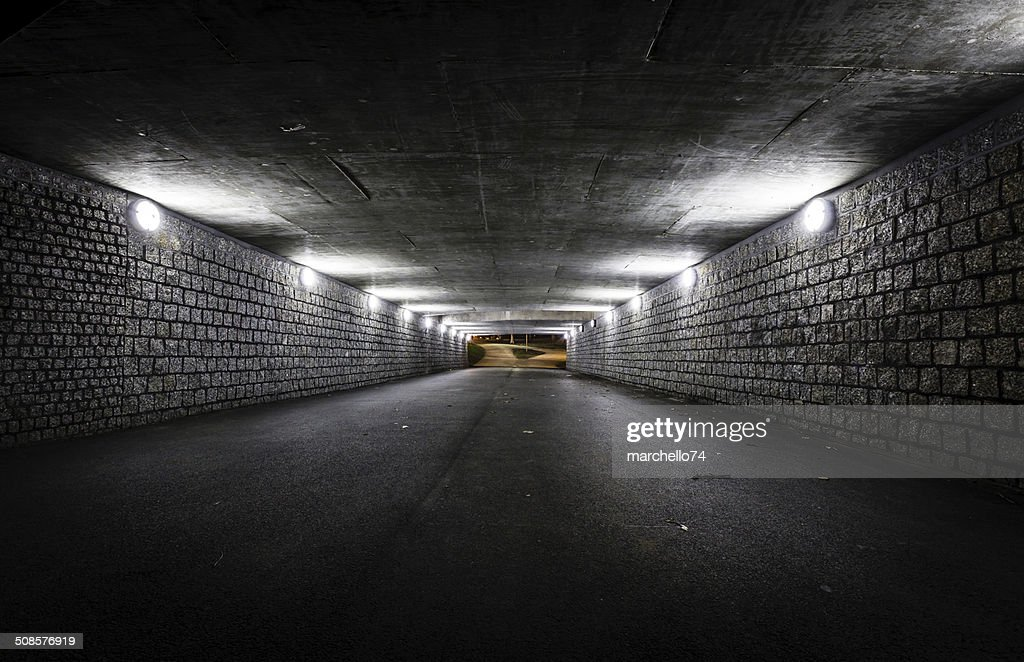 Empty dark tunnel at night : Stock Photo
