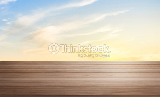 Empty Dark Wood Table Top With Dramatic Cloudy Sky